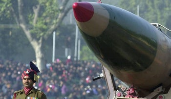 Indian Army officers stand near a Prithvi missile carried on display during the Republic Day parade in New Delhi, India, in this Jan. 26, 2005 file photo