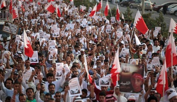 File photo: Thousands of Bahraini anti-government protesters chant slogans during a march in A'ali, Bahrain, April 18, 2014.