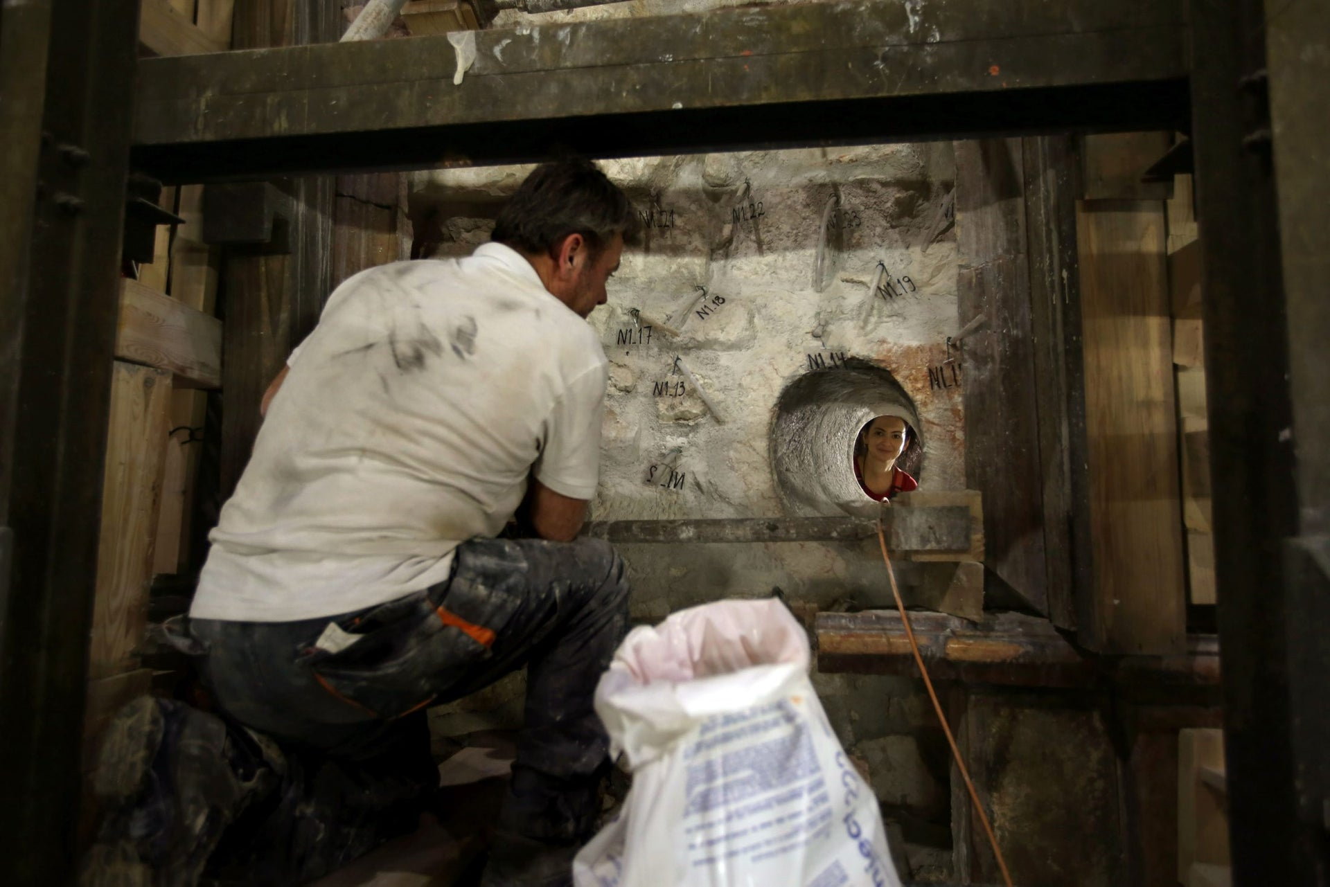 Greek preservation experts work to strengthen the Adicule surrounding the Tomb of Jesus, where his body is believed to have been laid, as part of conservation work done by the Greek team in Jerusalem on late on October 28, 2016.
