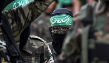 Masked youth cadets from the Ezzedine al-Qassam Brigades, the armed wing of the Palestinian Islamist Hamas movement, march in the southern Gaza Strip city of Khan Yunis on September 15, 2017.