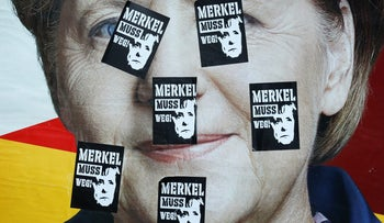 A defaced election campaign poster of the Christian Democratic Union (CDU) party, with a headshot of German Chancellor Angela Merkel, ahead of general elections in Germany, is pictured at a park in Frankfurt, Germany, September 20, 2017