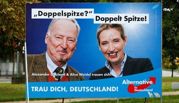 A defaced billboard showing Alexander Gauland, left, and Alice Weidel, top candidates of the anti-immigration party Alternative for Germany (AfD), in Berlin, September 14, 2017.