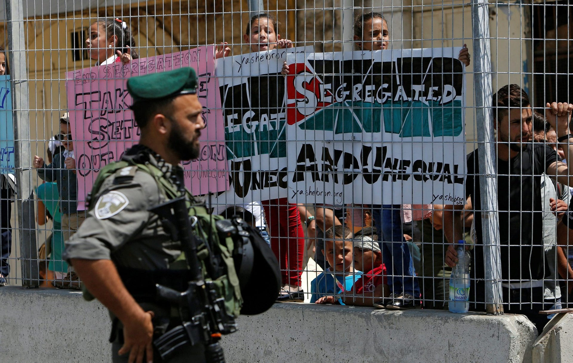 An Israeli policeman stands guard during a protest by Palestinians in the Old City of Hebron, West Bank, September 3, 2017.