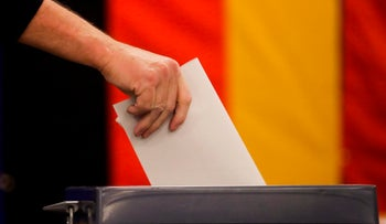 A voter casts for Germany's general election at a polling station in Berlin, September 24, 2017.