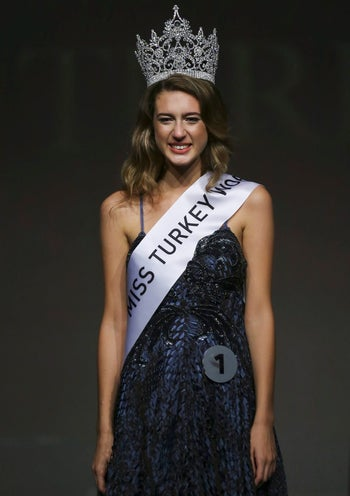 In this photo taken on Thursday, Sept. 21, 2017, Itir Esen, 18, smiles after being crowned as Miss Turkey 2017 in Istanbul