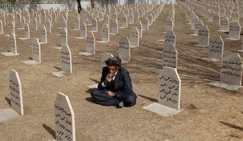 A cemetery for victims from the 1988 chemical attack in the Kurdish town of Halabja, March 16, 2013.