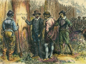 Illustration depicts John White (c1540 - c1593) and others as they find a tree into which is carved the word 'Croatoan,' Roanoke Island, North Carolina, 1590. Three years previously, White had left a group of colonists on the island and returned to England for supplies, intending to return in a matter of months, but a variety of circumstances (not the least of which was Britain's war with Spain) prevented his immediate return. When he was able to get back to the colony, it had been abandoned with only the word on the tree as a clue (the nearby Hatteras Island was then known as Croatoan).