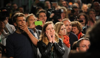 Supporters of the Alliance 90/The Greens party react on first exit polls in Berlin, Germany, September 24, 2017