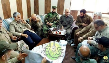 Akram Kaabi, the leader of Nujaba, sits in in the Falluja operations room with Qassem Soleimani, Hadi al Ameri and Abu Mahdi al Muhandis in Falluja, Iraq on May 24, 2016.