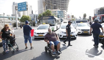 Disabled activists block the Ayalon Highway in Tel Aviv, September 24, 2017.