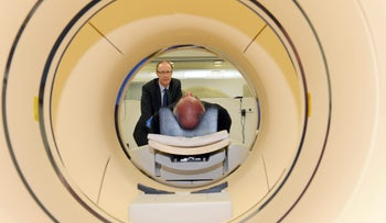 Christopher Rowe looking on as scientist and Vietnam veteran David Hay, lies in a positron emission tomography (PET) scanner in Melbourne, Australia, May 7, 2015: Scanning for Alzheimer's damage.