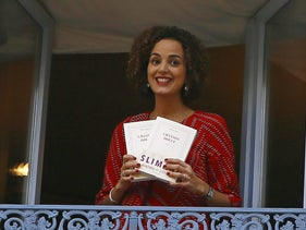 Leila Slimani smiles at the restaurant Chez Drouant after winnig the 2016 Goncourt literary prize for her book Chanson Douce (Sweet Song) , in Paris, Thursday Nov. 3, 2016. The Goncourt is France's most prestigious literary prize.