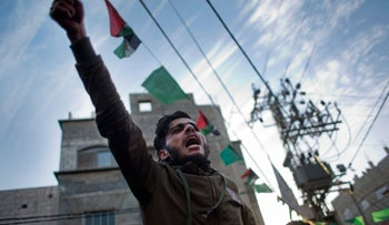 A Palestinian chants slogans during a demonstration against the chronic power cuts in Jabaliya refugee camp, Northern Gaza Strip, January 12, 2017.