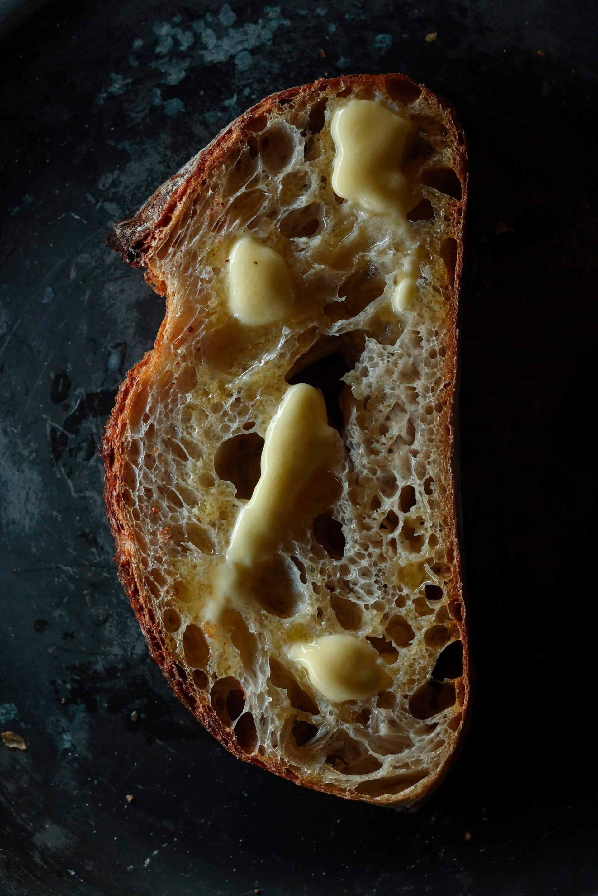 A fresh slice of bread with butter.