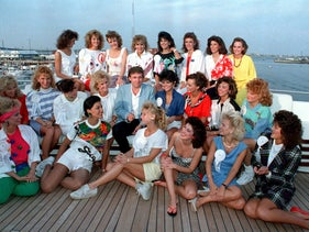 Donald Trump posing with some of the contestants in the 1988 Miss America beauty pageant, on board his yacht in Atlantic City.