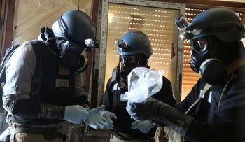 UN chemical weapons experts at one of the sites of an alleged chemical weapons attack in the Ain Tarma neighborhood of Damascus, Syria, August 29, 2013.