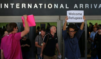 "Retired engineer John Wider, 59, holds up a sign reading ""Welcome Refugees"" at the international arrivals terminal  at Los Angeles International Airport in Los Angeles, California, U.S., June 29, 2017."