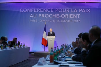 French Foreign Minister Jean-Marc Ayrault addresses delegates at the opening of the Mideast peace conference in Paris on January 15, 2017.