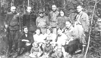 Jewish partisans safeguarding Jewish families in Nazi-occupied Poland, May 1944.