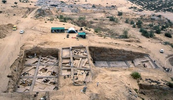 In this undated image taken in 2000, provided by the Palestinian Department of Antiquities, an aerial view of the excavations at Tel Es-Sakan, shows houses dating to 2600-2300 B.C., left, and fortifications from the late fourth millennium B.C, south of Gaza City. Palestinian and French archaeologists began excavating Gazaג€™s earliest archaeological site nearly 20 years ago; unearthing what they believe is a rare 4,500-year-old Bronze Age settlement. But over protests that grew recently, Gazaג€™s Hamas rulers have systematically destroyed the work since seizing power a decade ago, to make way for construction projects, and later military bases. (Pierre de Miroschedji/Palestinian Department of Antiquities, via AP)