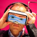Trying on VR headset at Mobile World Congress, Barcelona, last February.