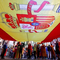 People hold a large flag of Spain as they take part in a pro-Spanish unity demonstration organised by the Catalan Civil Society organisation in Barcelona. October 8, 2017