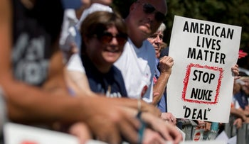 An attendee holds a sign opposed to the Iran nuclear deal during a Tea Party Patriots rally against the agreement on Capitol Hill, Washington, September 9, 2015.