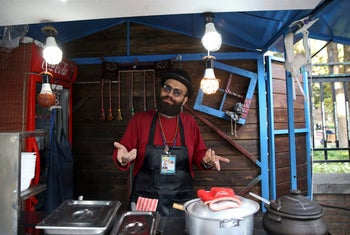 Hassan Aghaei, a 23-year-old street food vendor, speaks during an interview with The Associated Press in downtown Tehran, October 8, 2017.