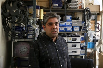 Mehdi Shakeri an importer of car parts speaks during an interview with The Associated Press at his shop in downtown Tehran, October 9, 2017.