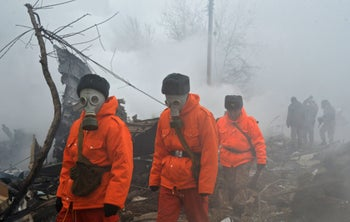 Rescue personnel at the crash site of a Turkish cargo plane in the village of Dacha-Suu outside Bishkek, January 16, 2017.
