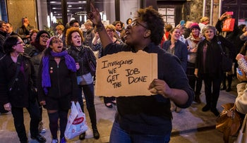 """Protesters shout at Vice President-elect Mike Pence as he leaves a New York theatre after a performance of """"Hamilton on November 18, 2016."""