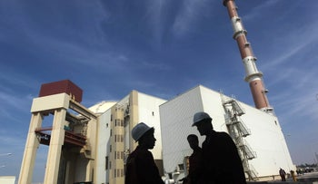 File photo: Iranian workers stand in front of the Bushehr nuclear power plant, about 1,200 km (746 miles) south of Tehran, October 26, 2010.