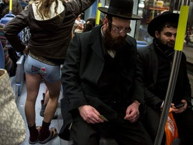 "A man without pants rides the Jerusalem light rail as part of the ""No Pants Subway Ride,"" January 15, 2017."