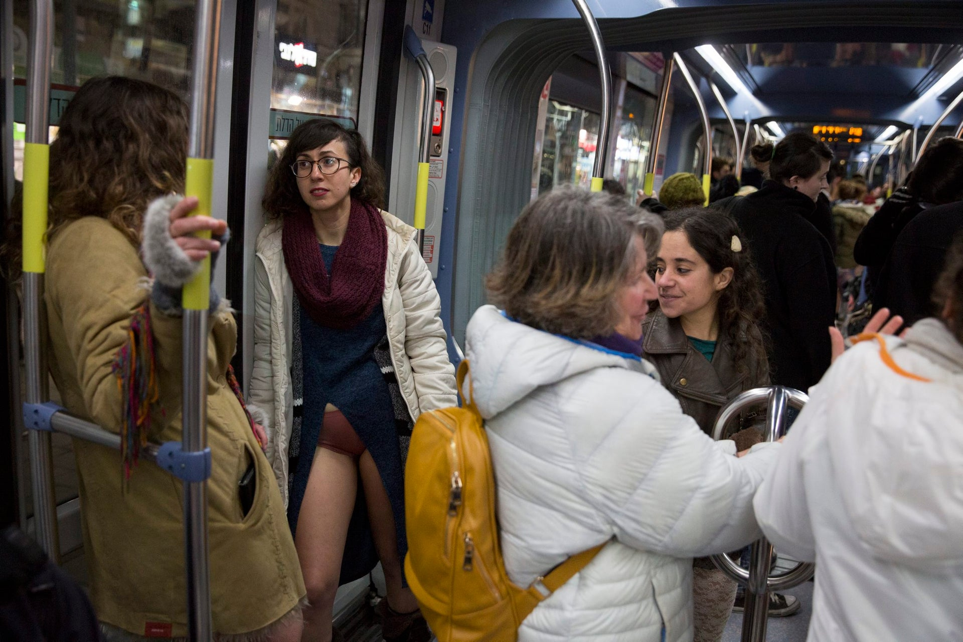 """Passengers on the Jerusalem light rail participate in the """"No Pants Subway Ride,"""" January 15, 2017."""