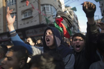 Palestinians chant slogans during a demonstration against the chronic power cuts in the Jabalya refugee camp, northern Gaza, January 12, 2017.