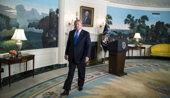 U.S. President Donald Trump leaves after delivering a statement on Iran in the Diplomatic Reception Room of the White House in Washington, D.C. on October 13, 2017.
