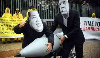Anti-nuclear activists wearing masks of U.S. President Donald Trump and North Korea's leader Kim Jong-un as they demonstrate in front of the U.S. embassy in Berlin, September 2017.