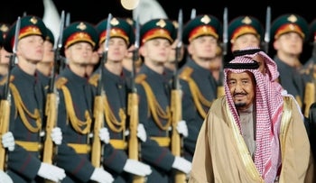 Saudi King Salman reviews a honor guards upon arrival in Moscow's Government Vnukovo airport in Russia on October 4, 2017.