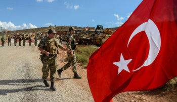Turkish soldiers stand near armored vehicles during a demonstration in support of Turkey's Idlib operation near the border with Syria, Reyhanli, Turkey, October 10, 2017.