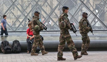 French soldiers on patrol at the Louvre during a security alert in August 2016.