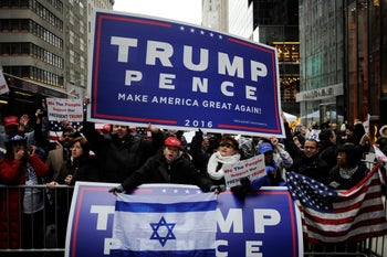 Supporters of U.S. President-elect Donald Trump shout at Trump protesters in a demonstration area near Trump Tower in the Manhattan borough of New York, U.S. November 20, 2016.