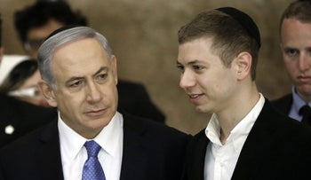 Prime Minister Benjamin Netanyahu, left, with his son Yair, at the Western Wall in Jerusalem, March 18, 2015.