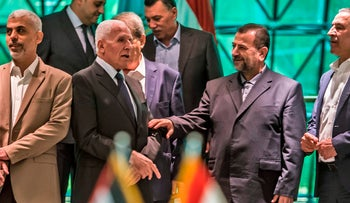 Heads of Fatah and Hamas delegations, Azzam al-Ahmad (left) and Saleh al-Aruri (right) after signing a reconciliation deal in Cairo, October 12, 2017.