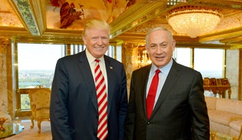 Israeli Prime Minister Benjamin Netanyahu (R) stands next to then-Republican U.S. presidential candidate Donald Trump during their meeting in New York, September 25, 2016.