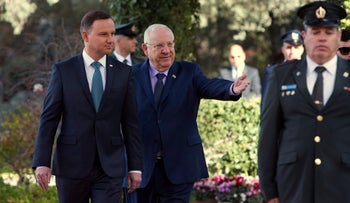 Rivlin, right, walks past an honor guard with Poland's President Andrzej Duda, at the President's Residence in Jerusalem, January 17, 2017.
