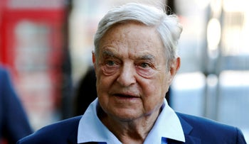 FILE PHOTO: Business magnate George Soros arrives to speak at the Open Russia Club in London, Britain June 20, 2016.