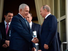 Russian President Vladimir Putin and Prime Minister Benjamin Netanyahu shake hands after their talks at the Black Sea resort of Sochi, Russia, August 23, 2017.