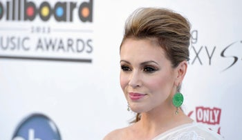 In this May 19, 2013, file photo, Alyssa Milano arrives at the Billboard Music Awards at the MGM Grand Garden Arena in Las Vegas.