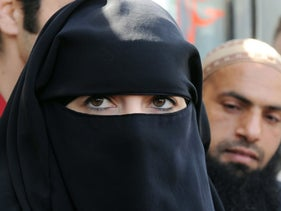 Anne, a French Muslim woman fined for driving while wearing a full-face veil, answers journalists' questions in Nantes, western France. April 23, 2010. A year later France banned the niqab in all public spaces