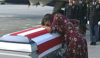 In this Tuesday, Oct. 17, 2017, frame from video, Myeshia Johnson cries over the casket of her husband, Sgt. La David Johnson, who was killed in an ambush in Niger